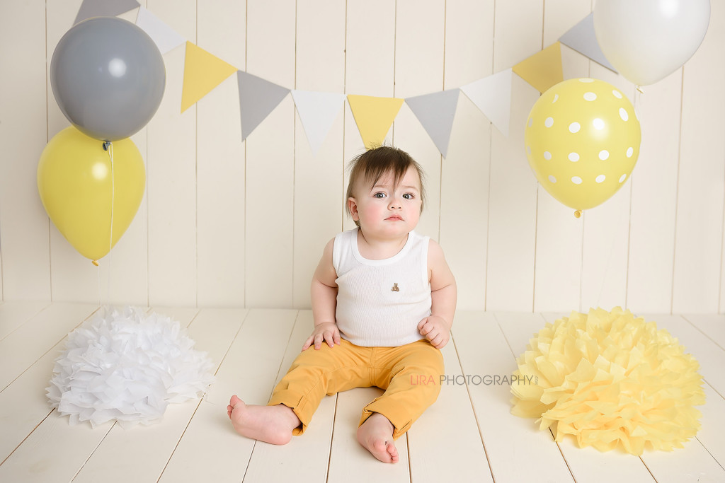 one year old boy with birthday decorations